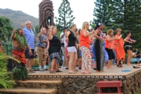 Delegates learning the hula